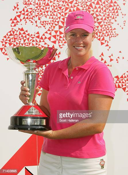 Brittany Lincicome poses with the championship trophy after winning her final against Juli Inkster 3 and 2 in the finals of the HSBC Women's World...