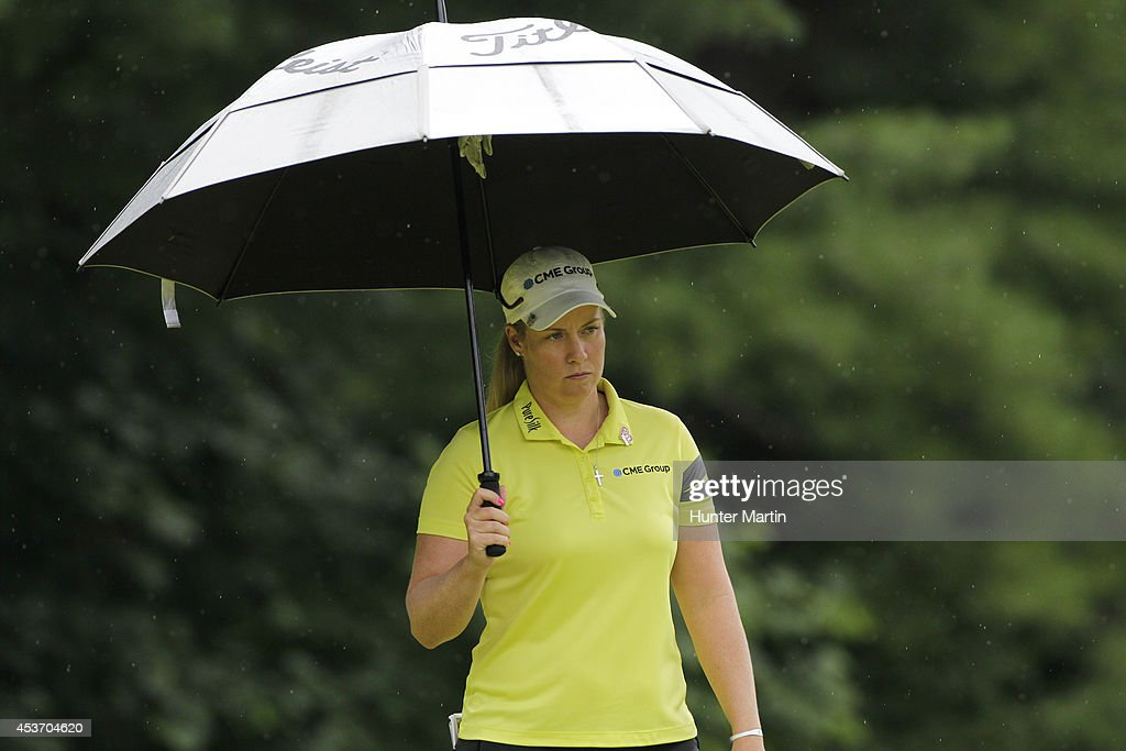 Brittany Lincicome stands under an umbrella on the fifth hole during the third round of the Wegmans LPGA Championship at Monroe Golf Club on August 16, 2014 in Pittsford, New York.