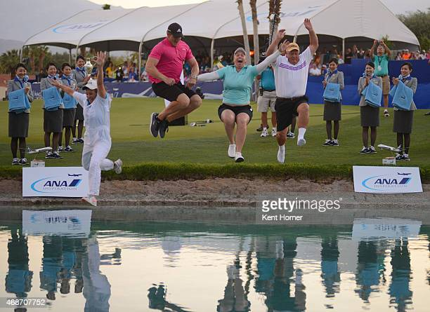 Brittany Lincicome with caddie and family members jumps into Poppy's Pond from the 18th green after winning the ANA Inspiration Round Four on the 3rd...