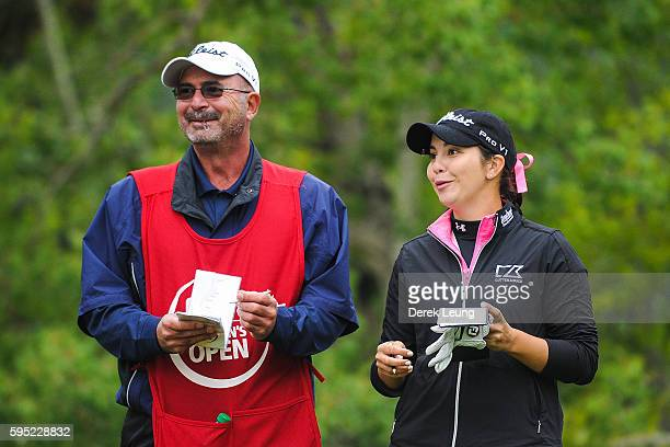 Brittany Marchand of Canada laughs with her caddy prior to her tee shot on the 11th hole during the first round of the Canadian Pacific Women's Open...