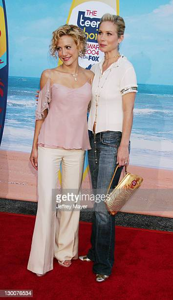 Brittany Murphy and Christina Applegate during The 2004 Teen Choice Awards Arrivals at Universal Ampitheatre in Universal City California United...