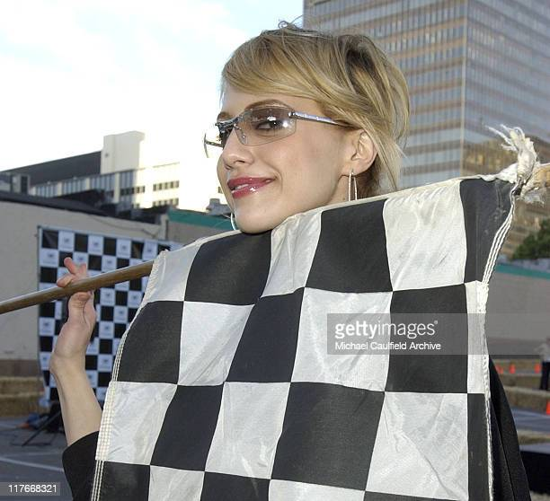 Brittany Murphy doing flag duty at the Cadillac Super Bowl Grand Prix an exclusive highgear SuperKart race where celebrities take it to the track to...