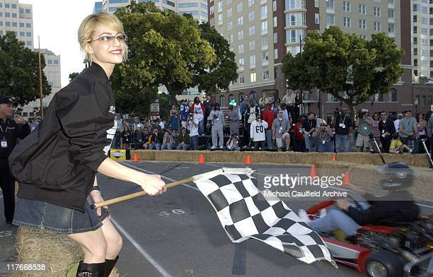 Brittany Murphy waves the checkered flag at the Cadillac Super Bowl Grand Prix an exclusive highgear SuperKart race where celebrities take it to the...