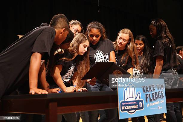 Brittany Ortiz and Jaimie Waxman and other high school students look at the signature of Florida Governor Rick Scott on Florida Senate Bill 52 after...
