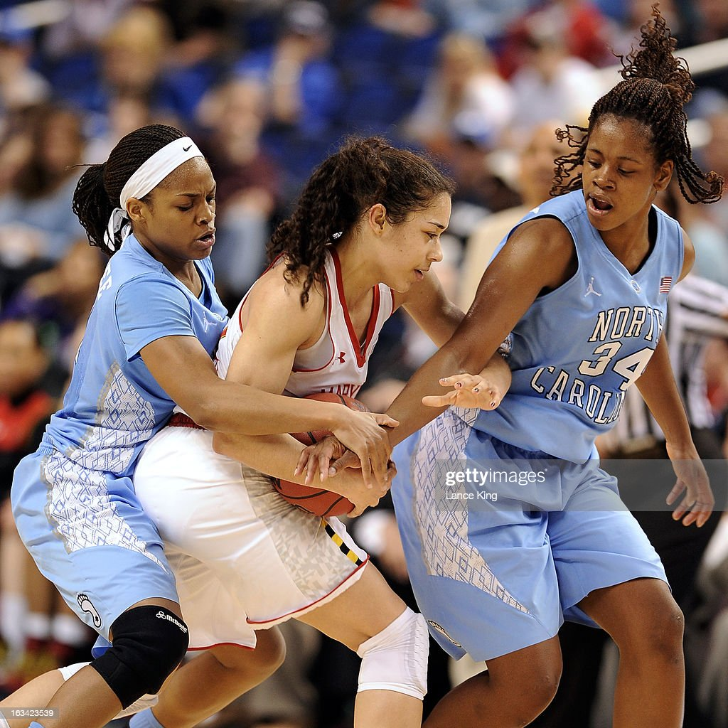 Brittany Rountree #11 and Xylina McDaniel #34 of the North Carolina Tar Heels pressure Chloe Pavlech #15 of the Maryland Terrapins during the semifinals of the 2013 Women's ACC Tournament at the Greensboro Coliseum on March 9, 2013 in Greensboro, North Carolina.