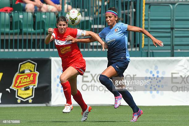 Brittany Taylor of the Western New York Flash and Nadia Nadim of the Sky Blue FC battle for a loose ball during the first half at Sahlen's Stadium on...