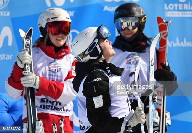 Britteny Cox of Australia celebrates after winning the gold medal as Justine DufourLapointe of Canada and Perrine Laffont of France look on during...
