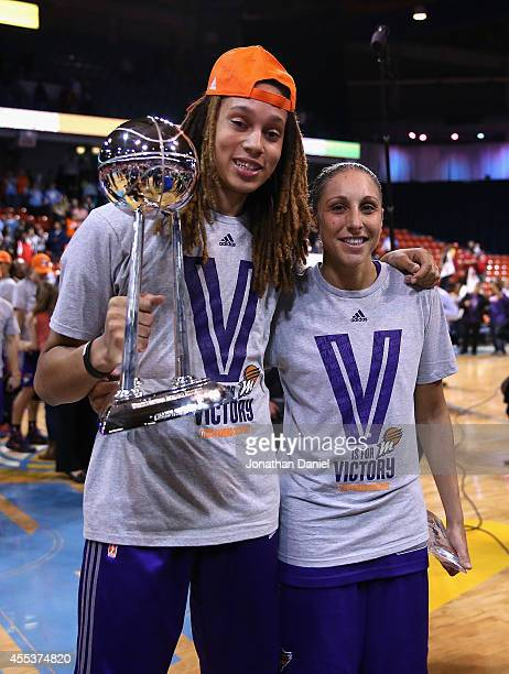 Brittney Griner and Diana Taurasi of the Phoenix Mercury pose after a championship win over the Chicago Sky during game three of the WNBA Finals at...