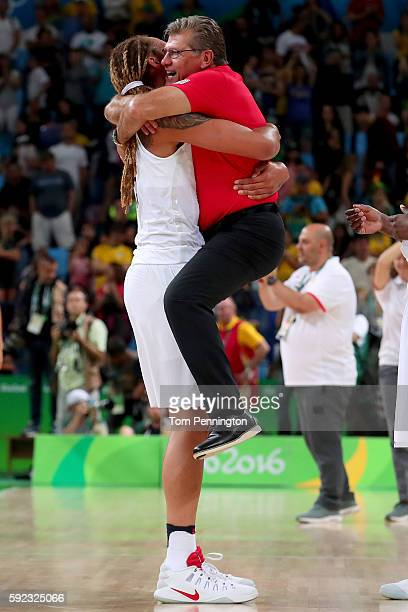 Brittney Griner and head coach Geno Auriemma of the United States celebrate winning the Women's Gold Medal Game between United States and Spain on...