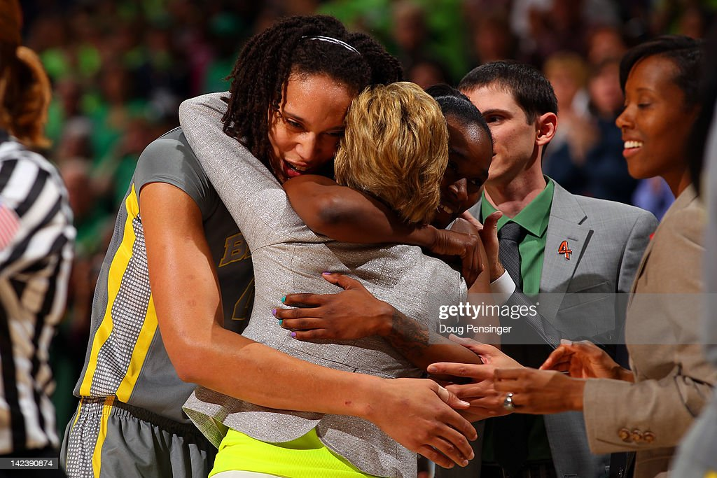 Brittney Griner and Jordan Madden of the Baylor Bears hug head coach Kim Mulkey after they won 8061 against the Notre Dame Fighting Irish during the...