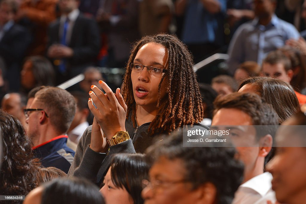Brittney Griner, first draft pick by the Phoenix Mercury, applauds during the game between the Atlanta Hawks and the New York Knicks on April 17, 2013 at Madison Square Garden in New York City, New York.
