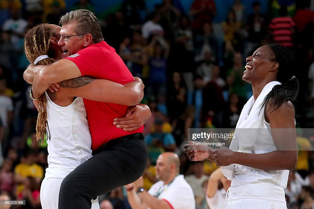 Brittney Griner head coach Geno Auriemma and Sylvia Fowles of the United States celebrate winning the Women's Gold Medal Game between United States...