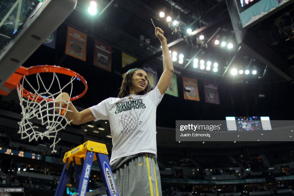 Brittney Griner of the Baylor Bears celebrates after she cuts down a piece of the net after they won 8061 against the Notre Dame Fighting Irish...