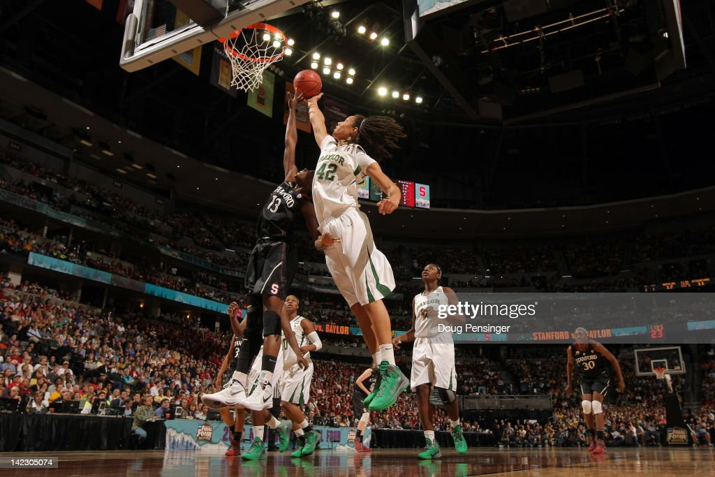 <a gi-track='captionPersonalityLinkClicked' href=/galleries/search?phrase=Brittney+Griner&family=editorial&specificpeople=6836945 ng-click='$event.stopPropagation()'>Brittney Griner</a> #42 of the Baylor Bears reaches for a rebound in the second half against Chiney Ogwumike #13 of the Stanford Cardinal during the National Semifinal game of the 2012 NCAA Division I Women's Basketball Championship at Pepsi Center on April 1, 2012 in Denver, Colorado.