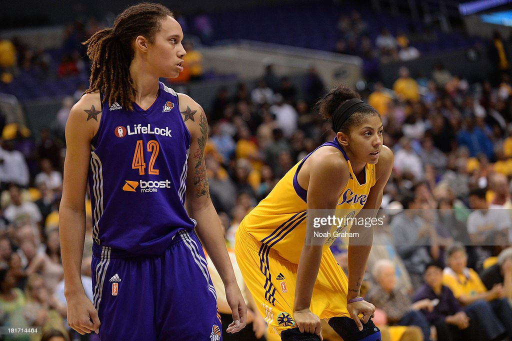 <a gi-track='captionPersonalityLinkClicked' href=/galleries/search?phrase=Brittney+Griner&family=editorial&specificpeople=6836945 ng-click='$event.stopPropagation()'>Brittney Griner</a> #42 of the Phoenix Mercury and <a gi-track='captionPersonalityLinkClicked' href=/galleries/search?phrase=Candace+Parker&family=editorial&specificpeople=752955 ng-click='$event.stopPropagation()'>Candace Parker</a> #3 of the Los Angeles Sparks stand next to each other in Game Three of the Western Conference Semifinal of the 2013 WNBA playoffs at Staples Center on September 23, 2013 in Los Angeles, California.