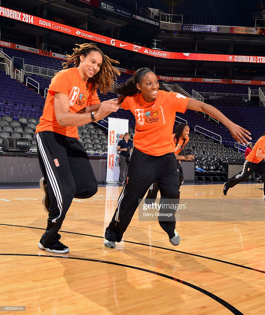 Brittney Griner of the Phoenix Mercury and Glory Johnson of the Tulsa Shock run during a WNBA AllStar Cares event on July 18 2014 at US Airways...