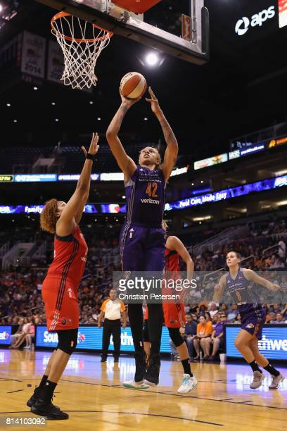 Brittney Griner of the Phoenix Mercury attempts a shot against Tianna Hawkins of the Washington Mystics during the second half of the WNBA game at...