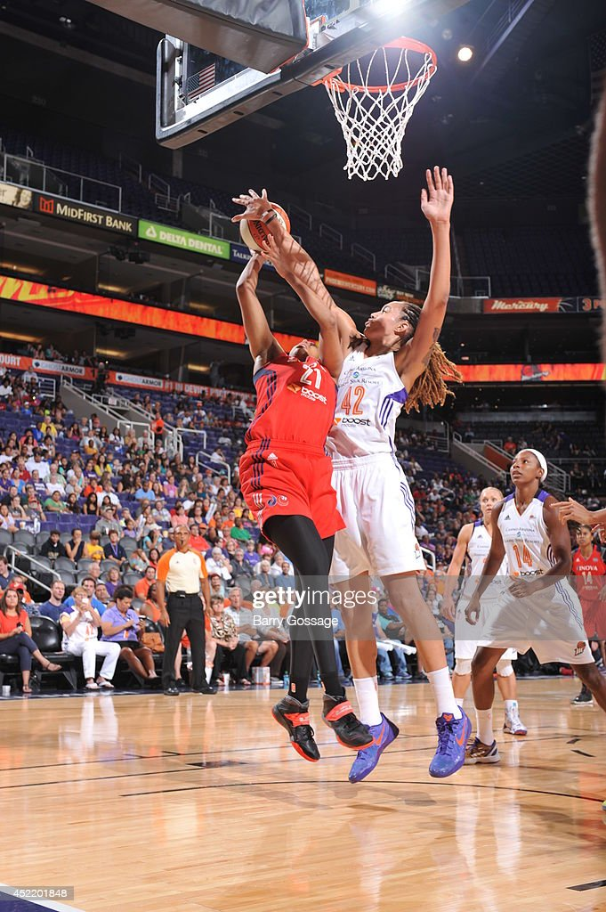<a gi-track='captionPersonalityLinkClicked' href=/galleries/search?phrase=Brittney+Griner&family=editorial&specificpeople=6836945 ng-click='$event.stopPropagation()'>Brittney Griner</a> #42 of the Phoenix Mercury blocks the shoot against <a gi-track='captionPersonalityLinkClicked' href=/galleries/search?phrase=Tianna+Hawkins&family=editorial&specificpeople=6559085 ng-click='$event.stopPropagation()'>Tianna Hawkins</a> #21 of the Washington Mystics on July 15, 2014 at US Airways Center in Phoenix, Arizona.