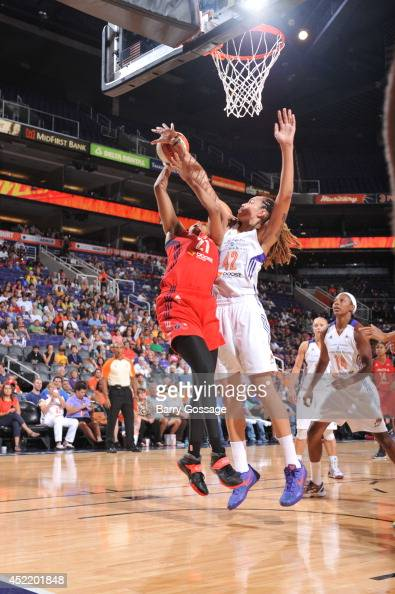 Brittney Griner of the Phoenix Mercury blocks the shoot against Tianna Hawkins of the Washington Mystics on July 15 2014 at US Airways Center in...