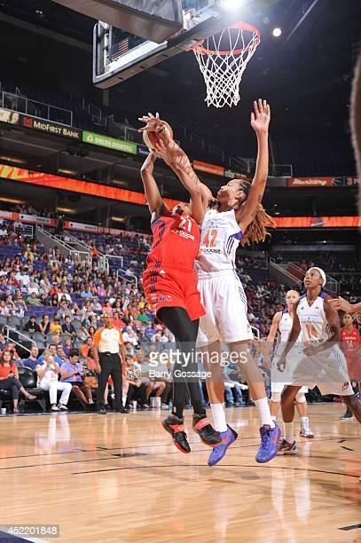 Brittney Griner of the Phoenix Mercury blocks the shoot against Tianna Hawkins of the Washington Mystics on July 15 2014 at US Airways Center in...