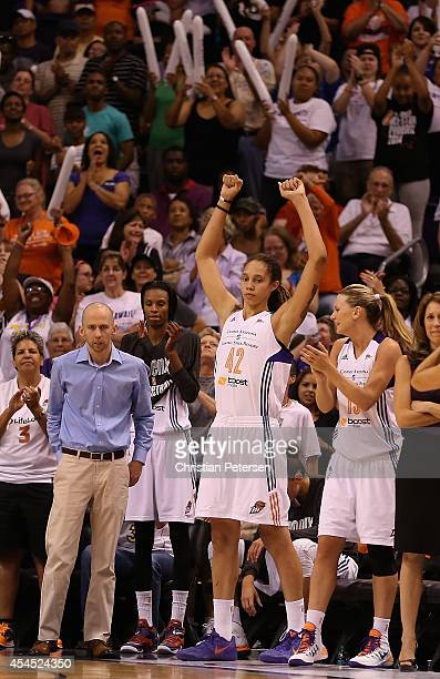 Brittney Griner of the Phoenix Mercury celebrates on the bench during the final moments before defeating the Minnesota Lynx 9678 in game three of the...