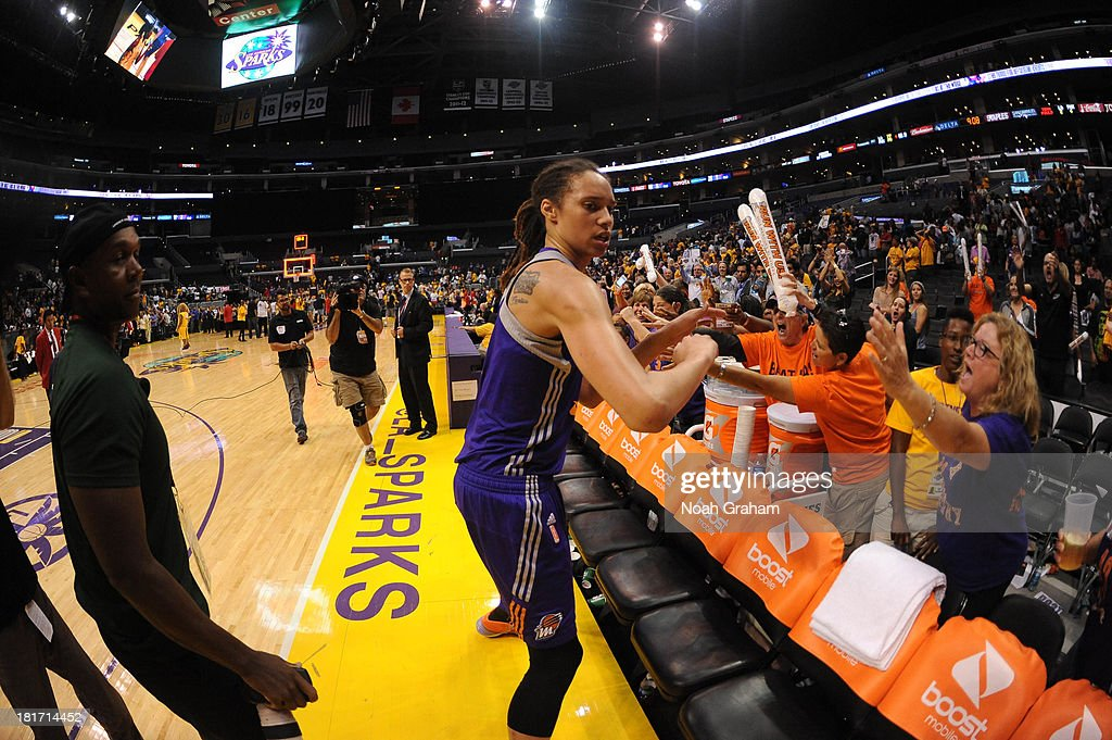 <a gi-track='captionPersonalityLinkClicked' href=/galleries/search?phrase=Brittney+Griner&family=editorial&specificpeople=6836945 ng-click='$event.stopPropagation()'>Brittney Griner</a> #42 of the Phoenix Mercury celebrates with fans after leading her team to victory over the Los Angeles Sparks in Game Three of the Western Conference Semifinal of the 2013 WNBA playoffs at Staples Center on September 23, 2013 in Los Angeles, California.