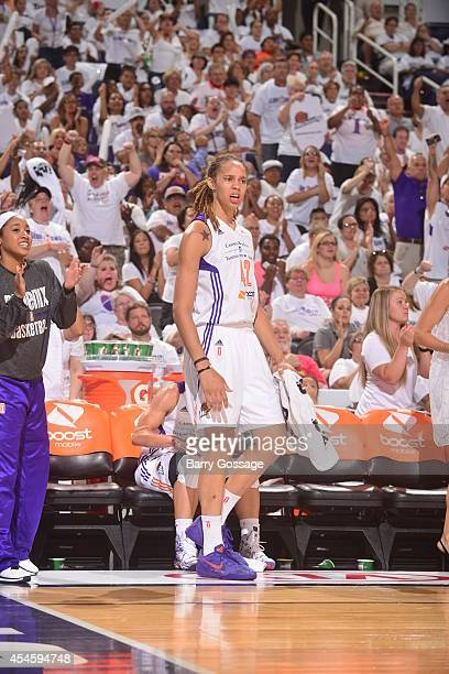 Brittney Griner of the Phoenix Mercury cheers for a play against the Minnesota Lynx in Game 1 of the 2014 WNBA Western Conference Finals on August 29...