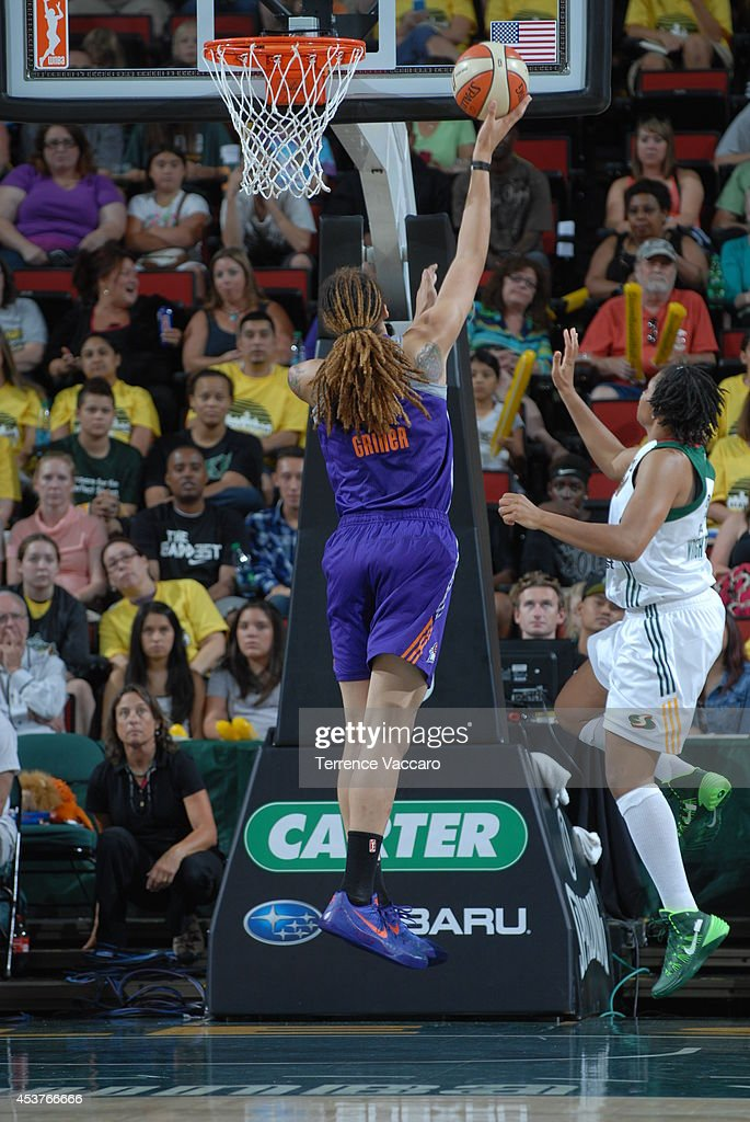 Brittney Griner #42 of the Phoenix Mercury drives to the basket against the Seattle Storm during the game on August 17, 2014 at Key Arena in Seattle, Washington.