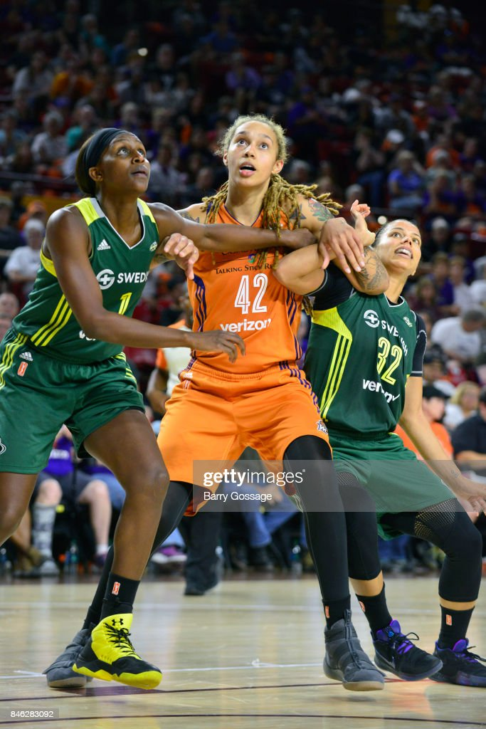 Brittney Griner #42 of the Phoenix Mercury fights for the position against Crystal Langhorne #1 and Alysha Clark #32 of the Seattle Storm in Round One of the 2017 WNBA Playoffs on September 6, 2017 at Arizona State University Wells Fargo Arena in Tempe, Arizona.