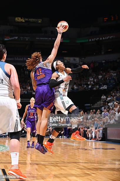 Brittney Griner of the Phoenix Mercury goes for the rebound against Maya Moore of the Minnesota Lynx during the WNBA Western Conference Finals Game 2...
