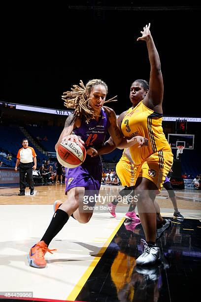 Brittney Griner of the Phoenix Mercury handles the ball against Courtney Paris of the Tulsa Shock on August 18 2015 at the BOK Center in Tulsa...