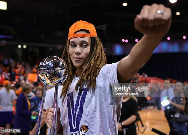 Brittney Griner of the Phoenix Mercury holds the championship trophy after a win over the Chicago Sky during game three of the WNBA Finals at the UIC...
