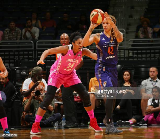 Brittney Griner of the Phoenix Mercury passes the ball against Krystal Thomas of the Washington Mystics on August 18 2017 at the Verizon Center in...