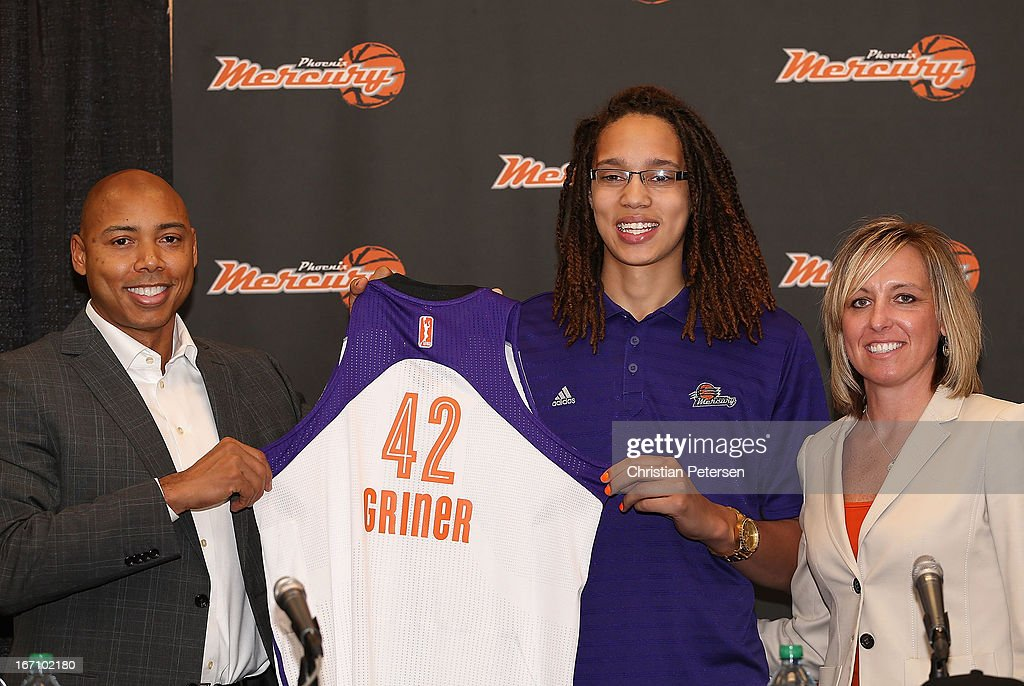 Brittney Griner (C) of the Phoenix Mercury poses with head coach Corey Gaines (L) and President/COO Amber Cox (R) during a press conference after being selected as the first pick in the 2013 WNBA Draft at US Airways Center on April 20, 2013 in Phoenix, Arizona.
