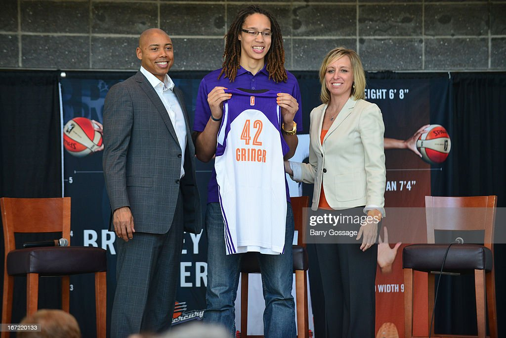 Brittney Griner #42 of the Phoenix Mercury (C) poses with head coach Corey Gaines (L) and President/COO Amber Cox (R) during a press conference for her introduction to the team on April 20, 2013 at US Airways Center in Phoenix, Arizona.