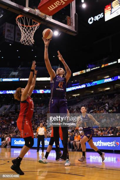 Brittney Griner of the Phoenix Mercury puts up a shot over Tianna Hawkins of the Washington Mystics during the second half of the WNBA game at...