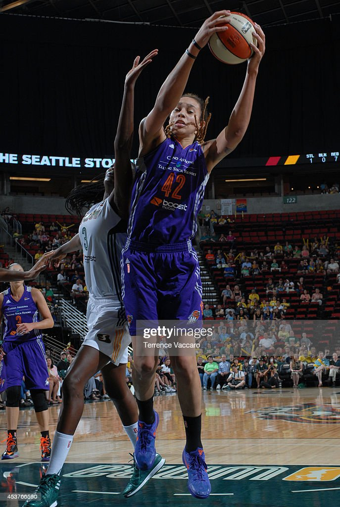 Brittney Griner #42 of the Phoenix Mercury rebounds the ball against the Seattle Storm during the game on August 17, 2014 at Key Arena in Seattle, Washington.