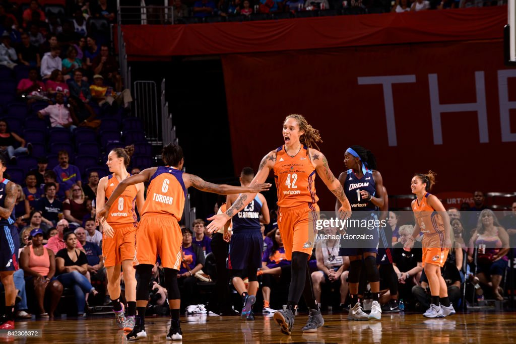Brittney Griner #42 of the Phoenix Mercury shakes hands with teammates during the game against the Atlanta Dream on September 3, 2017 at Talking Stick Resort Arena in Phoenix, Arizona.