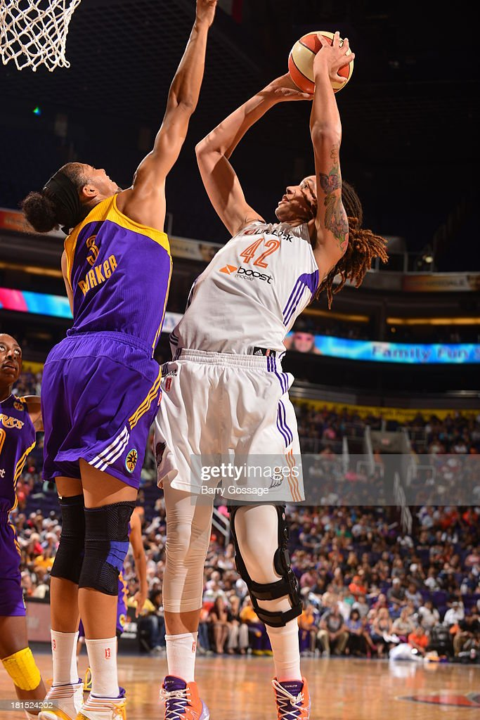 <a gi-track='captionPersonalityLinkClicked' href=/galleries/search?phrase=Brittney+Griner&family=editorial&specificpeople=6836945 ng-click='$event.stopPropagation()'>Brittney Griner</a> #42 of the Phoenix Mercury shoots against <a gi-track='captionPersonalityLinkClicked' href=/galleries/search?phrase=Candace+Parker&family=editorial&specificpeople=752955 ng-click='$event.stopPropagation()'>Candace Parker</a> #3 of the Los Angeles Sparks in Game 2 Round 1 of the 2013 WNBA Playoffs on September 13, 2013 at U.S. Airways Center in Phoenix, Arizona.