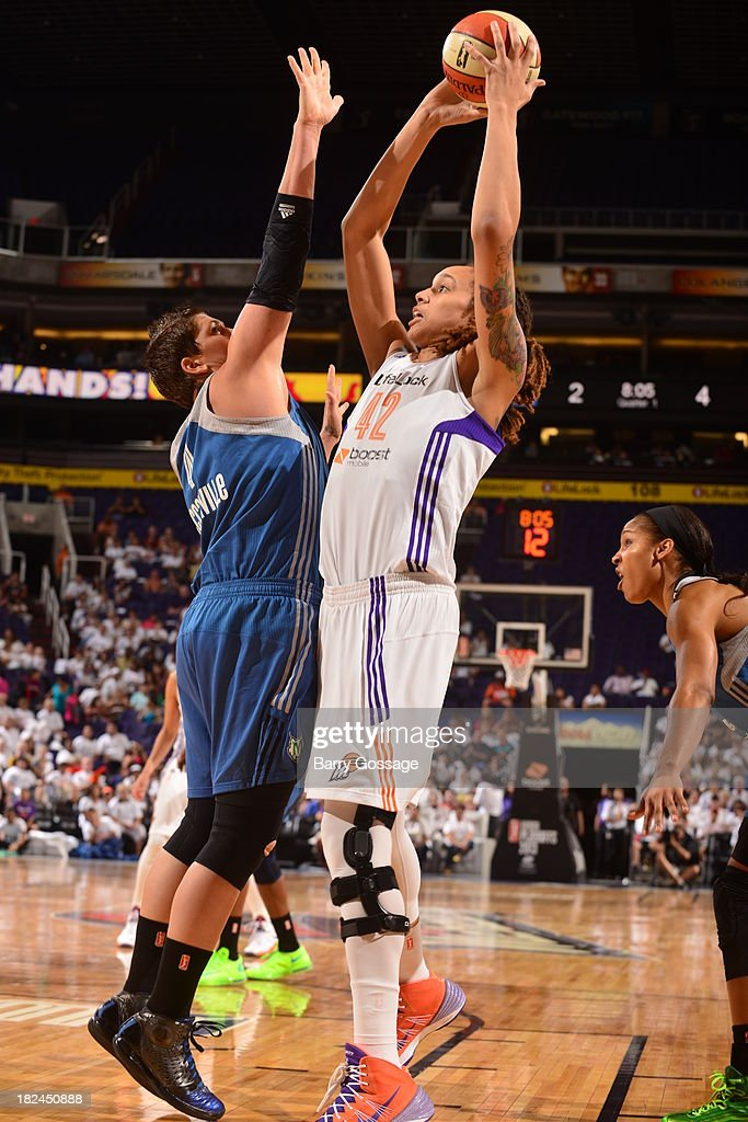 <a gi-track='captionPersonalityLinkClicked' href=/galleries/search?phrase=Brittney+Griner&family=editorial&specificpeople=6836945 ng-click='$event.stopPropagation()'>Brittney Griner</a> #42 of the Phoenix Mercury shoots against <a gi-track='captionPersonalityLinkClicked' href=/galleries/search?phrase=Janel+McCarville&family=editorial&specificpeople=239106 ng-click='$event.stopPropagation()'>Janel McCarville</a> #4 of the Minnesota Lynx in Game 2 of the Western Conference Finals during 2013 WNBA Playoffs on September 29, 2013 at U.S. Airways Center in Phoenix, Arizona.