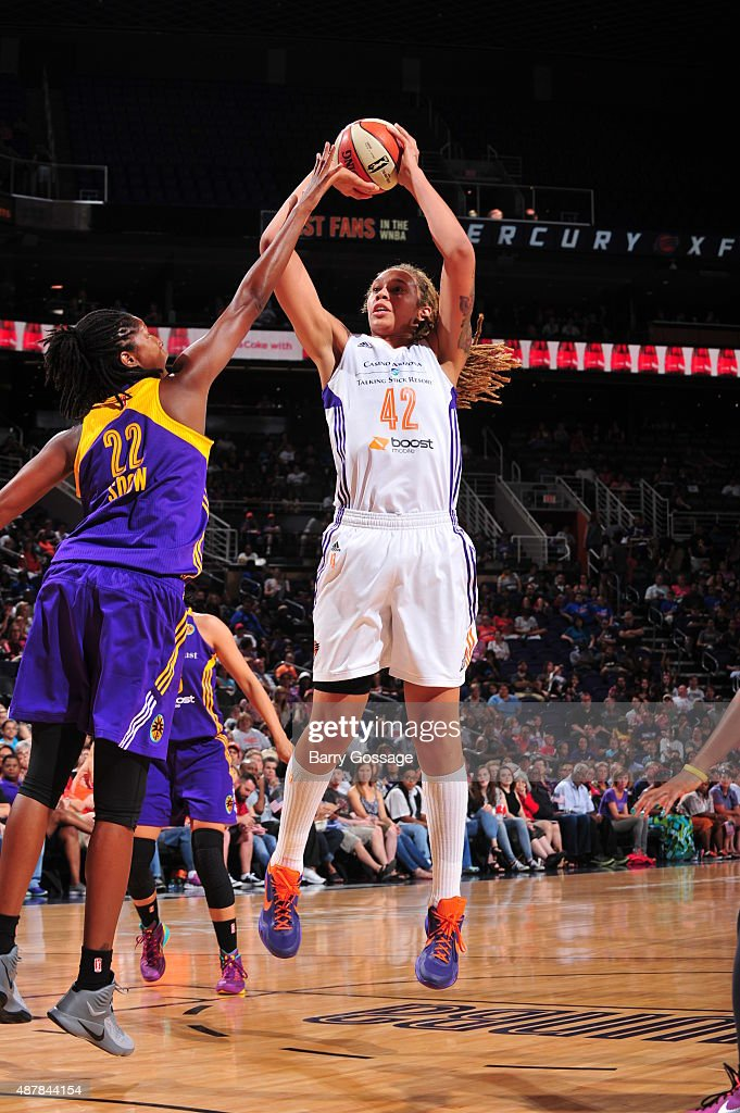 <a gi-track='captionPersonalityLinkClicked' href=/galleries/search?phrase=Brittney+Griner&family=editorial&specificpeople=6836945 ng-click='$event.stopPropagation()'>Brittney Griner</a> #42 of the Phoenix Mercury shoots against <a gi-track='captionPersonalityLinkClicked' href=/galleries/search?phrase=Michelle+Snow&family=editorial&specificpeople=208195 ng-click='$event.stopPropagation()'>Michelle Snow</a> #22 of the Los Angeles Sparks on September 11, 2015 at the US Airways Center in Phoenix, Arizona.