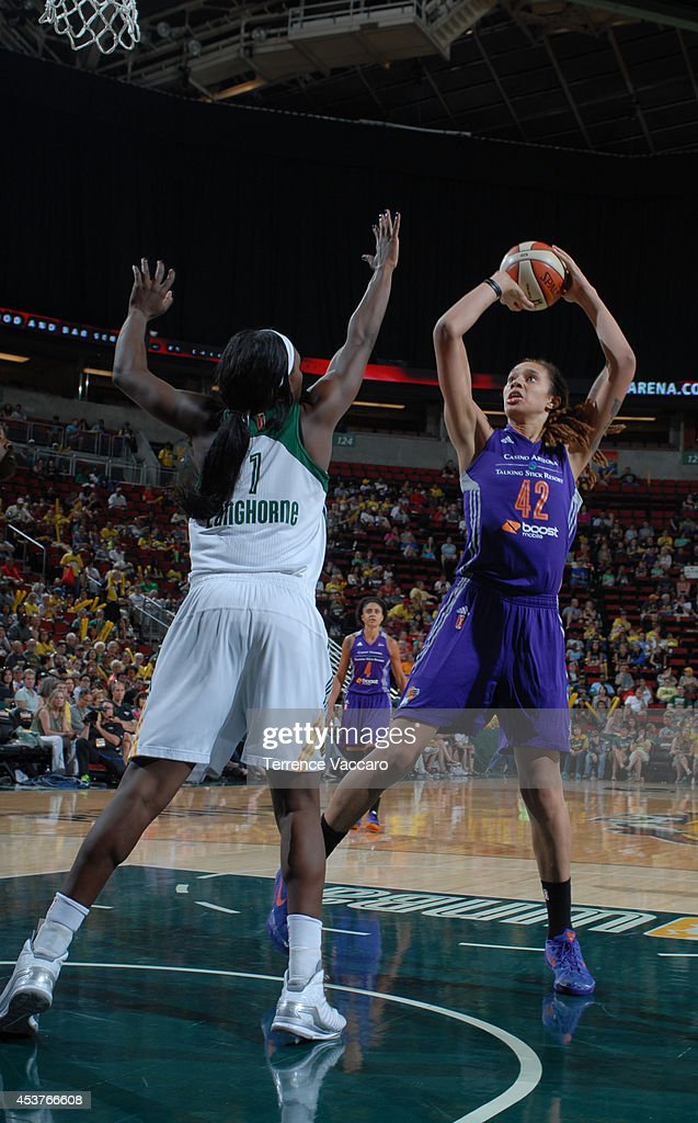 Brittney Griner #42 of the Phoenix Mercury shoots the ball against Crystal Langhorne #1 of the Seattle Storm during the game on August 17, 2014 at Key Arena in Seattle, Washington.
