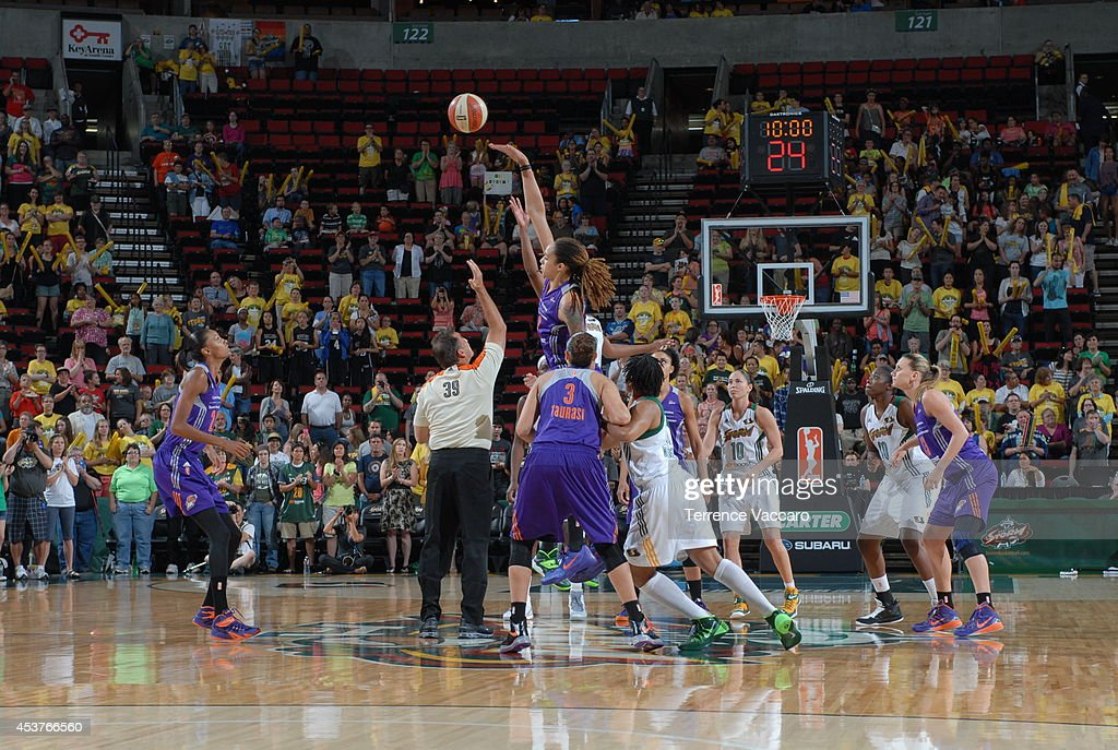 Brittney Griner #42 of the Phoenix Mercury tips off the game against the Seattle Storm during the game on August 17, 2014 at Key Arena in Seattle, Washington.