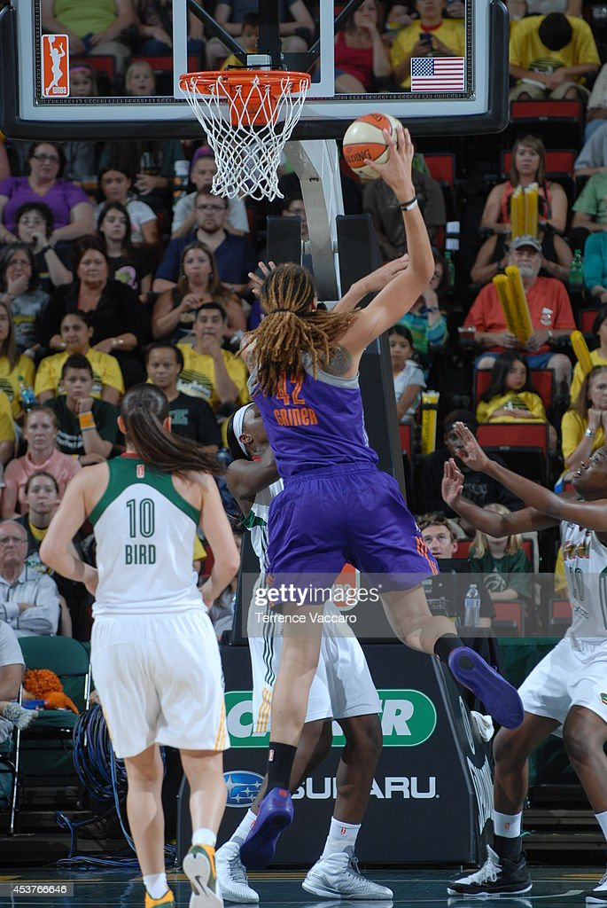 <a gi-track='captionPersonalityLinkClicked' href=/galleries/search?phrase=Brittney+Griner&family=editorial&specificpeople=6836945 ng-click='$event.stopPropagation()'>Brittney Griner</a> #42 of the Phoenix Suns drives to the basket against the Seattle Storm during the game on August 17, 2014 at Key Arena in Seattle, Washington.