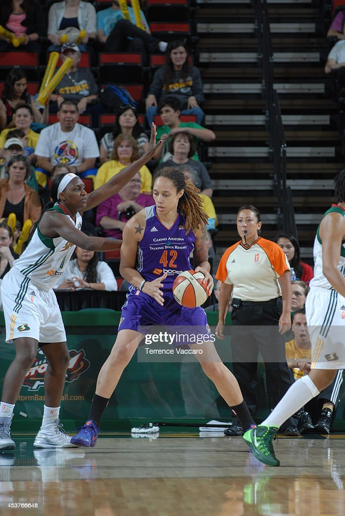 <a gi-track='captionPersonalityLinkClicked' href=/galleries/search?phrase=Brittney+Griner&family=editorial&specificpeople=6836945 ng-click='$event.stopPropagation()'>Brittney Griner</a> #42 of the Phoenix Suns posts up against Crystal Langhorne #1 of the Seattle Storm during the game on August 17, 2014 at Key Arena in Seattle, Washington.