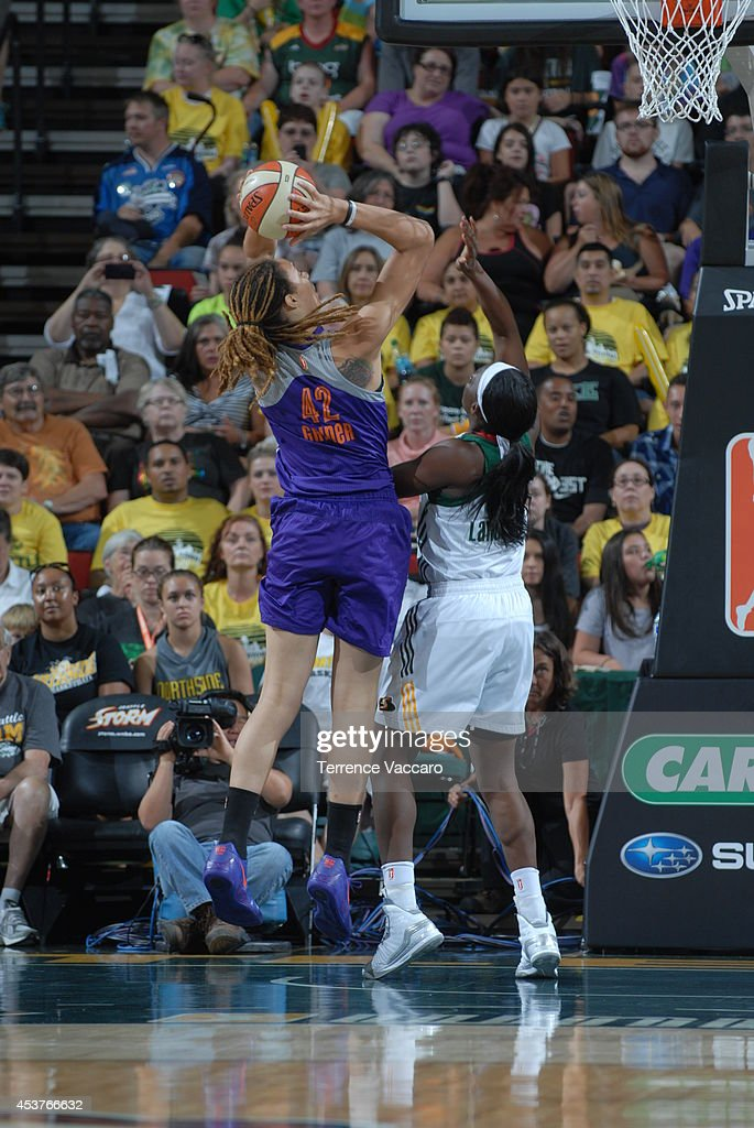 <a gi-track='captionPersonalityLinkClicked' href=/galleries/search?phrase=Brittney+Griner&family=editorial&specificpeople=6836945 ng-click='$event.stopPropagation()'>Brittney Griner</a> #42 of the Phoenix Suns shoots the ball against Crystal Langhorne #1 of the Seattle Storm during the game on August 17, 2014 at Key Arena in Seattle, Washington.