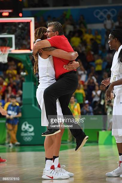 Brittney Griner of the USA Women's National Basketball Team and Head Coach Geno Auriemma of the USA Women's National Basketball Team celebrate...