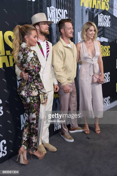 Brittney Kelley Brian Kelley and Tyler Hubbard of Florida Georgia Line and Hayley Hubbard attend the 2017 CMT Music Awards at the Music City Center...