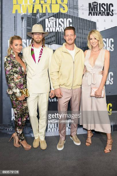 Brittney Kelley singers Brian Kelley and Tyler Hubbard of music group Florida Georgia Line and Hayley Hubbard attend the attend the 2017 CMT Music...