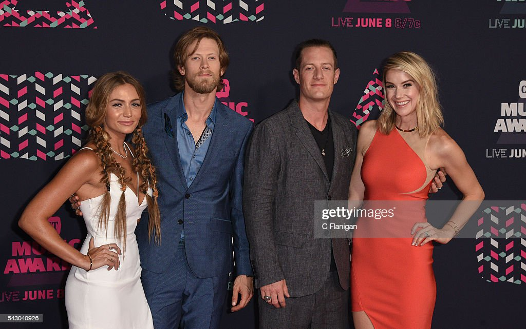 Brittney Marie Cole Brian Kelley and Tyler Hubbard from musical group Florida Georiga Line and Hayley Hubbard attends the 2016 CMT Music awards at...